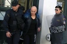 Αστυνομικοί συνοδεύουν τον βαρυποινίτη Παναγιώτη Βλαστό μετά την απολογία του στον ανακριτή για την υπόθεση της μαφίας των φυλακών, στα δικαστήρια της πρώην Σχολής Ευελπίδων, Αθήνα, την Τρίτη 3 Μαρτίου 2015. ΑΠΕ-ΜΠΕ/ΑΠΕ-ΜΠΕ/ΣΥΜΕΛΑ ΠΑΝΤΖΑΡΤΖΗ